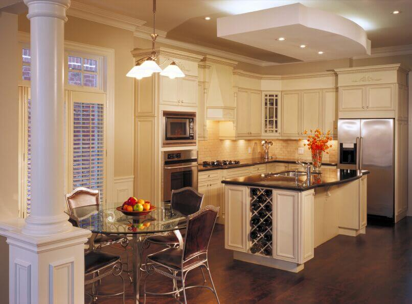 Cream cabinets warm up this room without darkening it and balances the