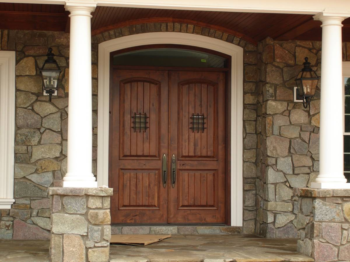 front door lighting with stone walls