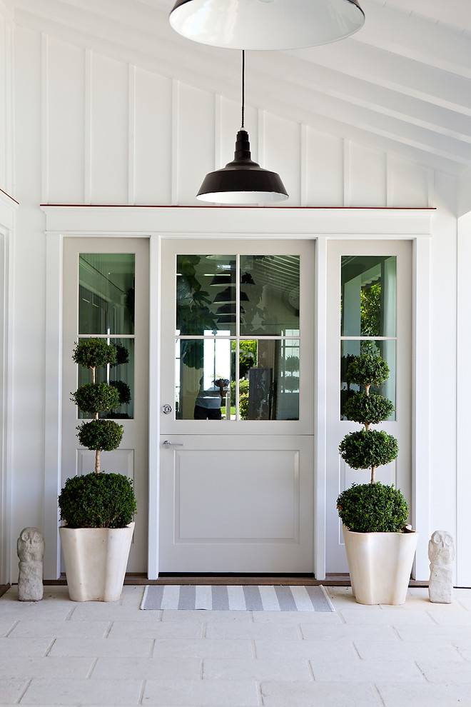 beach style entry with pendant lights